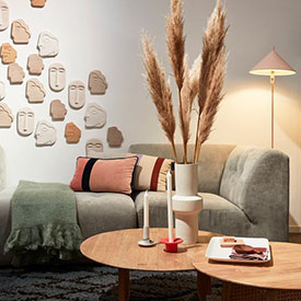 HKLIVING living room design with gray couch and wooden coffee tables from Maison & Objet 2019