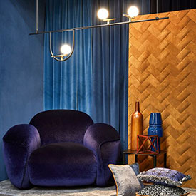 LOPFICIO purple velvet chair with a textured wood wall from Maison & Objet 2019