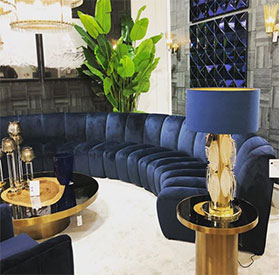 SOFA AND FRIENDS living room design with dark blue couch and gold lamp with dark blue shade