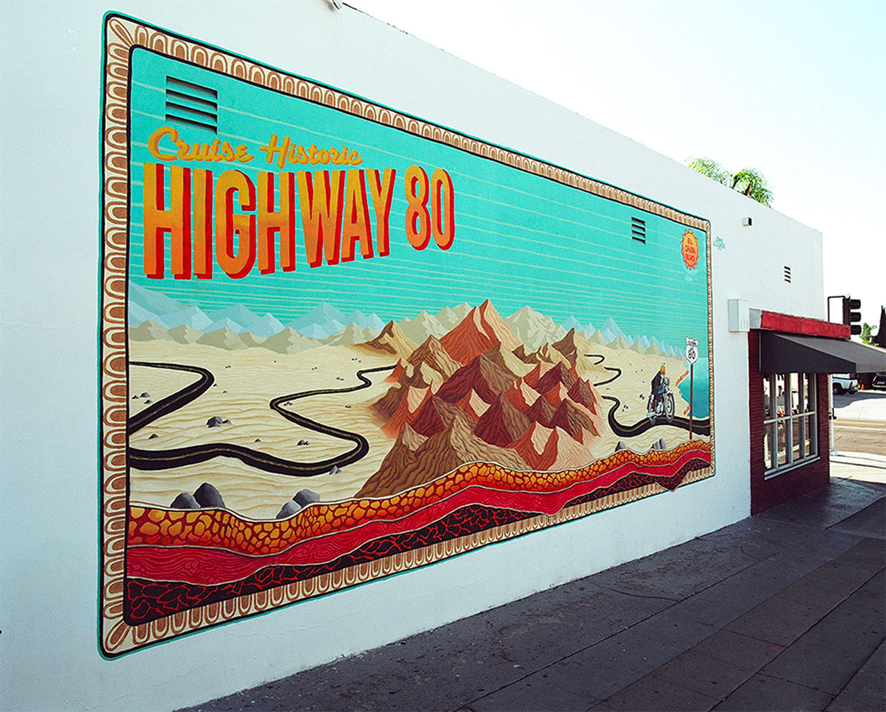 mural of cruise highway 80 outside of a retail store in a desert town